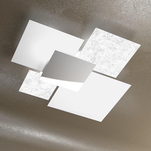 top light shadow 1088 90 fa La base metallica centrale è in metallo con finitura cromo lucido mentre cambiano le finiture dei vetri sono quadrati. Nel caso delle plafoniere sono 4 di cui 2 sono forniti sempre bianche e per gli atri 2 si può scegliere tra la finitura Nero, Foglia Argento, Foglia Oro e naturalmente anche tutto bianco.